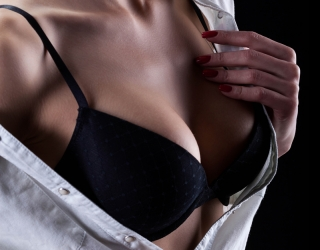 Woman Revealing Breasts